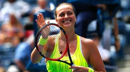 Petra Kvitova of Czech Republic reacts after defeating