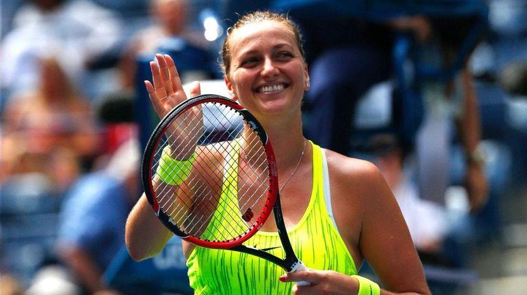 Petra Kvitova of Czech Republic reacts after defeating