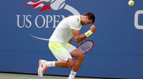 Grigor Dimitrov, of Bulgaria, reacts after winning a
