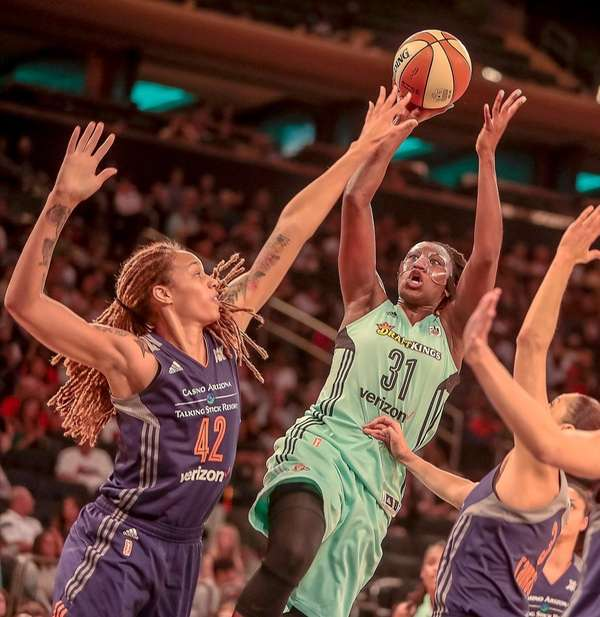 Tina Charles of the Liberty goes to the