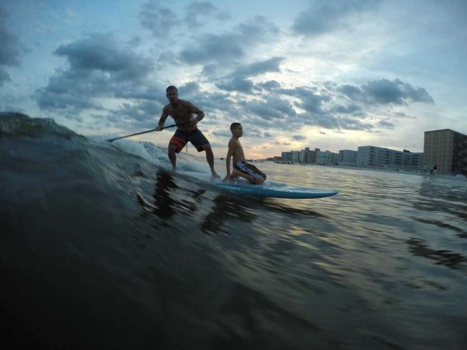 Uncle and nephew riding the waves in Long