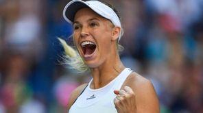Caroline Wozniacki of Denmark celebrates after defeating Madison