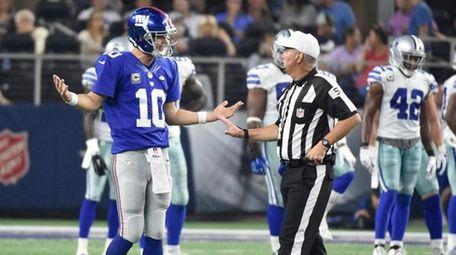 New York Giants quarterback Eli Manning (10) argues