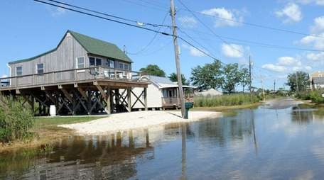 Riviera Drive in Mastic Beach begins to flood