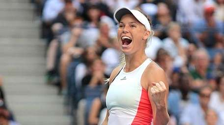 Caroline Wozniacki reacts after defeating Madison Keys in