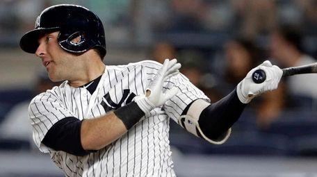 New York Yankees' Austin Romine follows through on