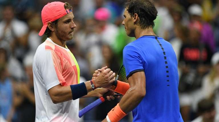 Lucas Pouille of France shakes hands with Rafael