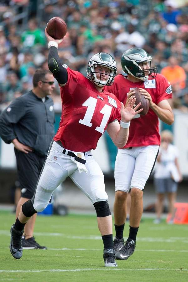 Philadelphia Eagles quarterback Carson Wentz, left, throws the