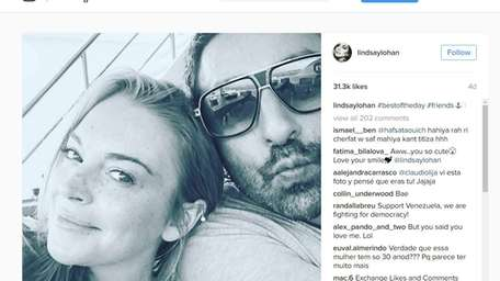 Lindsay Lohan and Dennis Papageorgiou appear in an