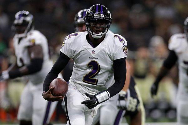 Josh Johnson of the Baltimore Ravens runs with