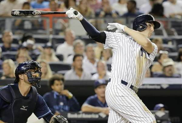 New York Yankees' Greg Bird follows through and