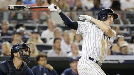 New York Yankees' Greg Bird follows through and