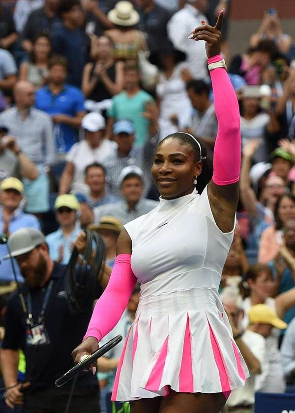 Serena Williams reacts after she wins her match