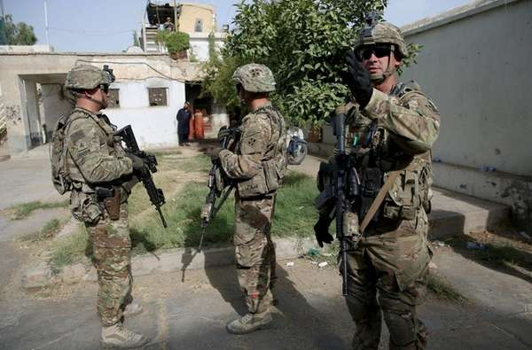 U.S. military forces stand guard during a visit