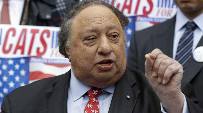 John Catsimatidis talks to the media during a