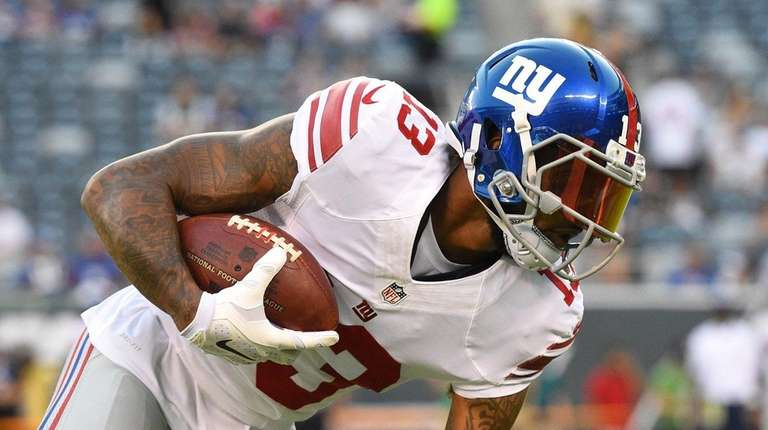 Giants receiver Odell Beckham warms up prior to