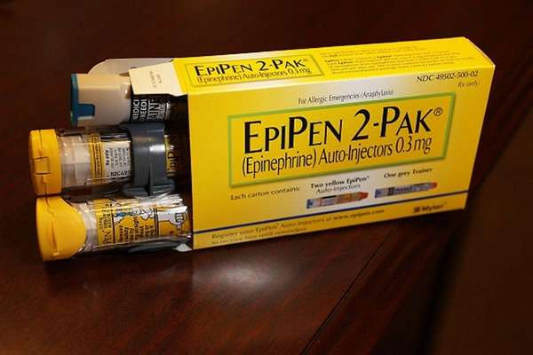 EpiPen, which dispenses epinephrine through an injection mechanism