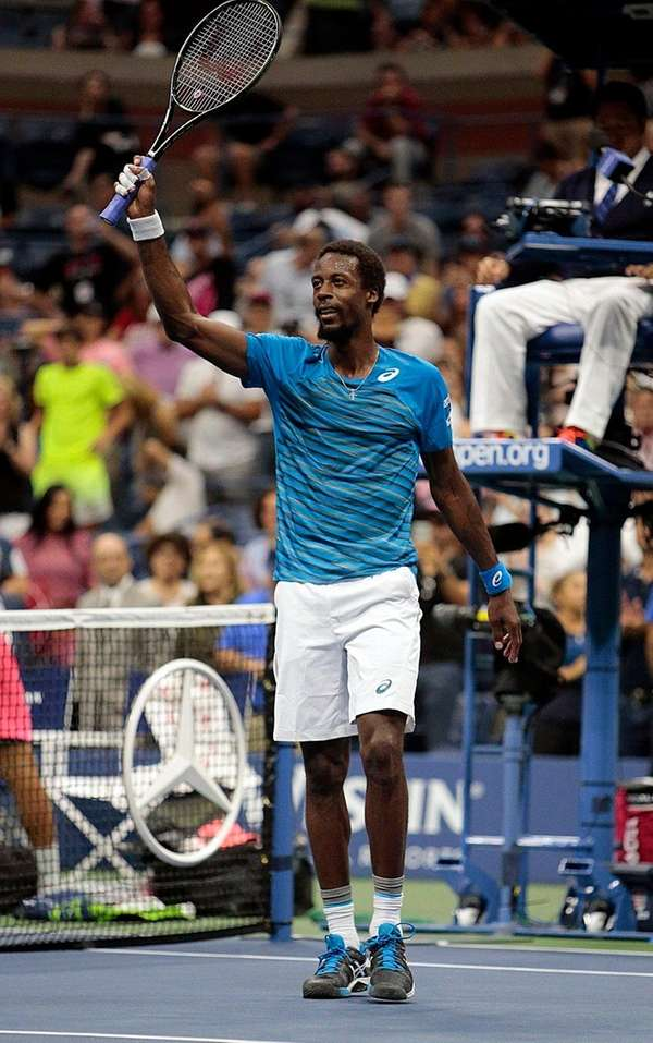 Gael Monfils responds to the fans after a