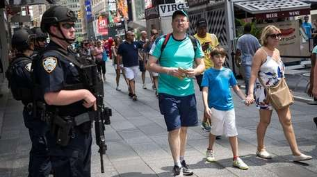 Members of the NYPD stand guard in Times