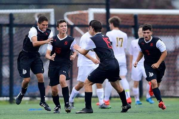 Syosset's C.J. Emmerich is congratulated by his teammates