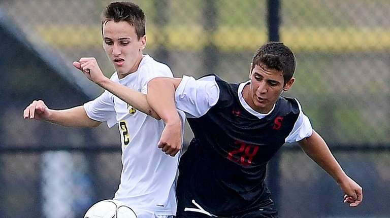 Syosset's Sal Inglima battles for the ball with