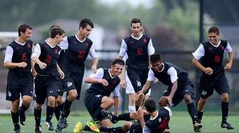 Syosset's CJ Emmerich is congratulated by his teammates