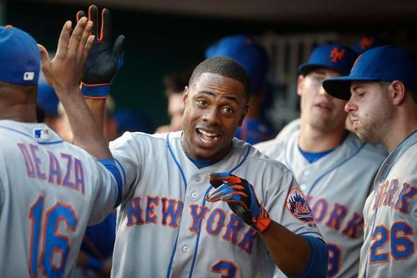 Curtis Granderson celebrates in Mets' dugout after