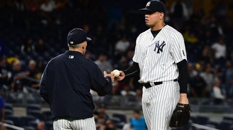 A rare sight: Yankees manager Joe Girardi, left,