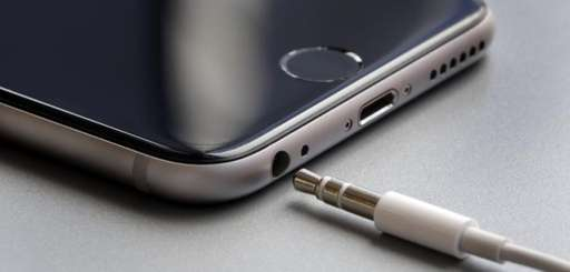 The earphone jack and charging port on an