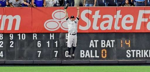 New York Yankees Brett Gardner celebrates after making