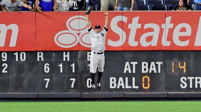 New York Yankees Brett Gardner celebrates after making