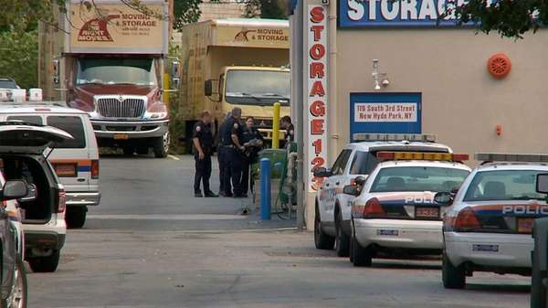 Nassau County police investigate a robbery at 123