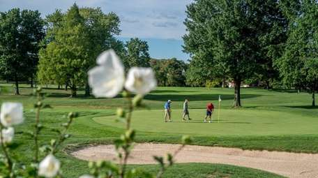 The Village Club at Lake Success includes an