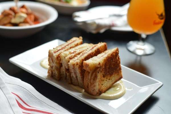 A ham and cheese toasted sandwich, with truffle