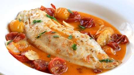 Tilapia is gently simmered in seasoned tomato broth.