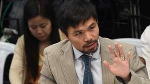 Philippine boxing icon-turned senator Manny Pacquiao gestures as