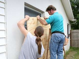 A father and son working together to install