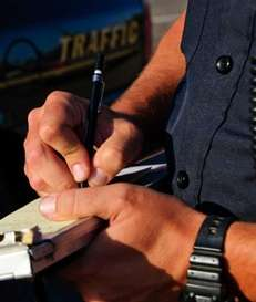 A photo of a police officer writing a