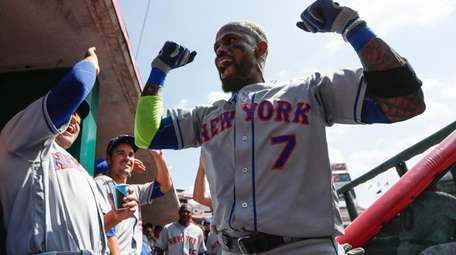 New York Mets' Jose Reyes celebrates in the