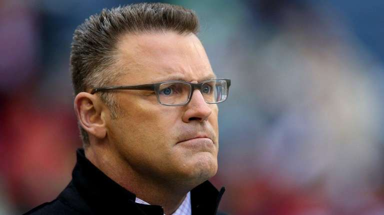 Fox football analyst Howie Long looks on before
