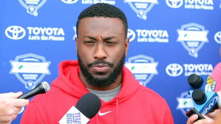 Giants safety Nat Berhe speaks during training