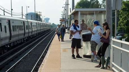 People wait for trains at the Bethpage LIRR