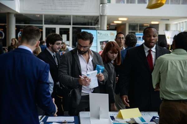 Job seekers browse the many companies during the