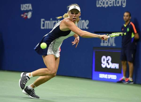 Caroline Wozniacki of Denmark returns to Anastasija Sevastova