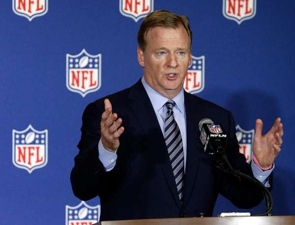 NFL commissioner Roger Goodell answers reporter's questions at