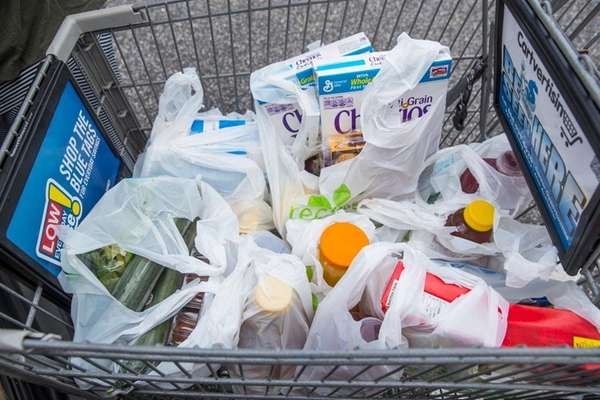 Plastic bags filled with groceries from the Stop