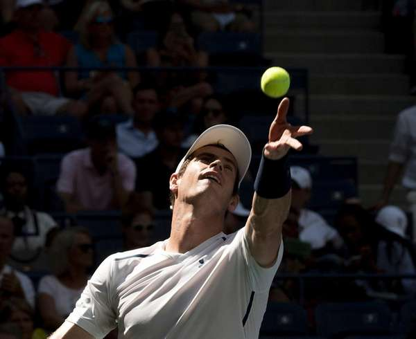 Andy Murray serves against Kei Nishikori in the
