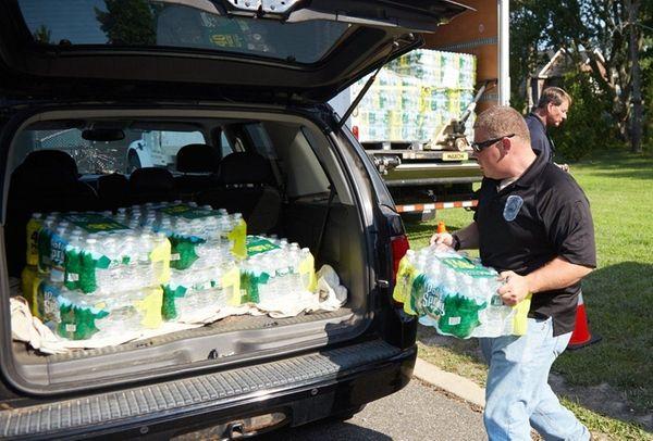 Scott Proser, from Suffolk County Fire Rescue, helps