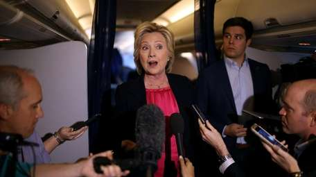 Hillary Clinton speaks to members of the media