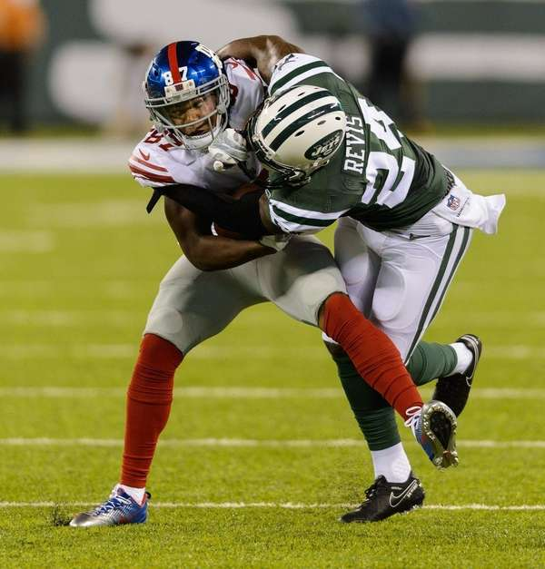 New York Jets cornerback Darrelle Revis (24) tackles